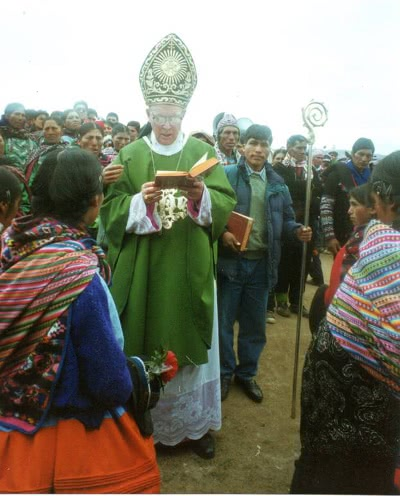 Bishop Molloy reading the Bible in Quechua.
