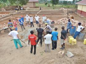 Germans, Spaniards and Ugandans build a school in Gomba, Uganda