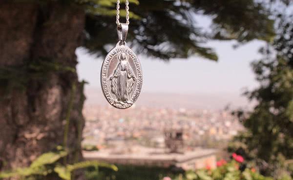Opus Dei - Per què portes la medalla del Carme?