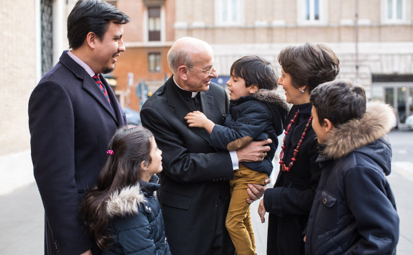 Mons. Ocáriz with a family, in Rome.