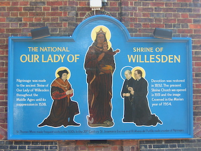 A plaque outside the Catholic Church of Our Lady of Willesden commemorates the visits to the church by two saints: St Thomas More and St Josemaría Escrivá (Painting © John Armstrong)