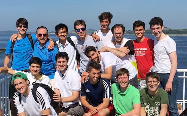 With other young Opus Dei members during a trip to Scotland, when the proton beam therapy gave him some months of respite from the cancer. Pedro is standing at the back, second from the right, in a red shirt