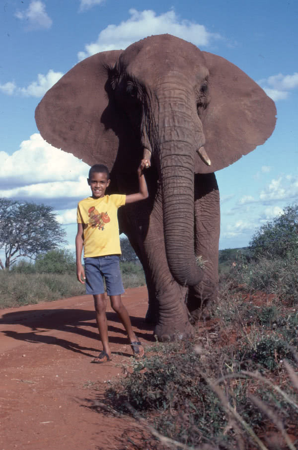 Paul Kioko, as a child, with an elephant