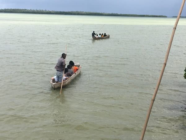 Crossing over from Mida Creek to Waka Waka Island on local boats