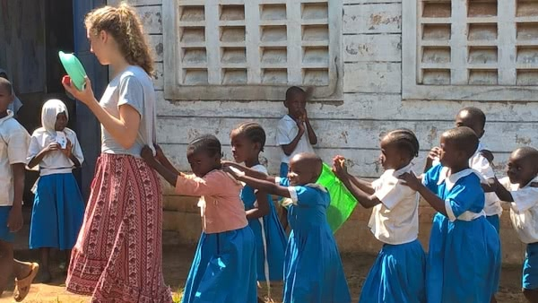 Barbara, originally from Brazil, employing fun class control tactics with the children