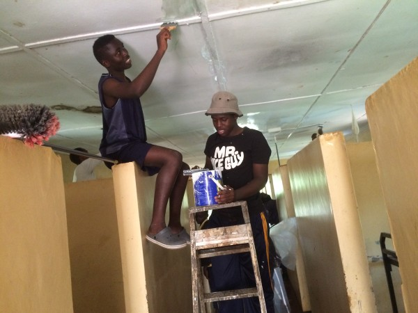 Moses and Trevor, both Form 2 students, paint one of the dormitories of Ogada Children's Home in Kisumu