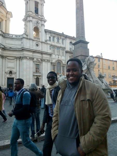 Simon, Andrew and Joseph walking along Piazza Navona