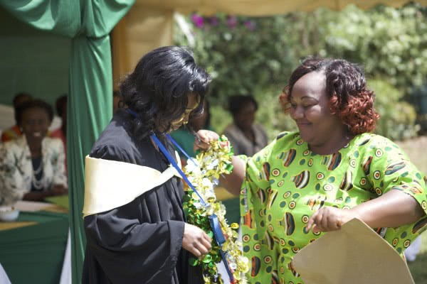 Valedictorian, Felistas Njoki with her mother during the graduation in January