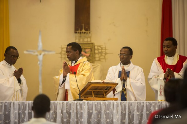 Fr. Martin concelebrates his homecoming Mass with his brother priests