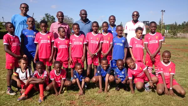Fathers and sons from Fahari Boys Club (Thika) all ready for a football game