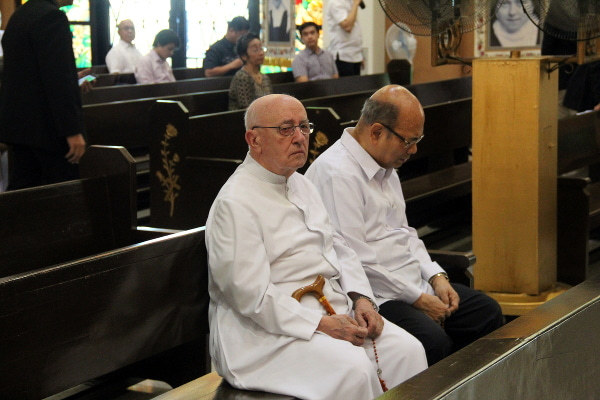 Father Javier de Pedro and Bernie Villegas before the funeral Mass