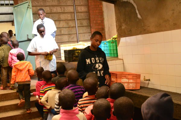 Some of the Form 2's serve food during the visit to St. Martin's Kibagare School