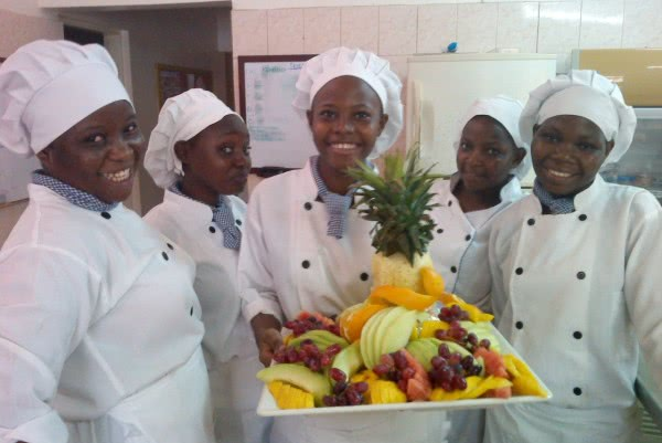 Group of students at Tewa with a colourful dish of fruit salad they had been working on