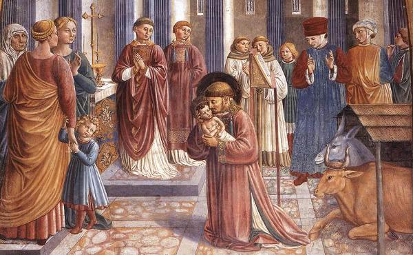 Representación del primer belén en Greccio, con san Francisco (Benozzo Gozzoli)