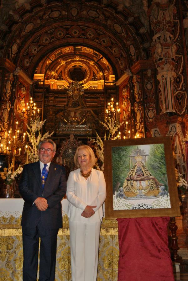 """El retrato que más le ha gratificado hacer es el de la Patrona de Granada, la Virgen de las Angustias, en el que ha puesto el mayor cariño, y con el que acaba de ganar el XI Certamen de Pintura """"Hipólito Llanes""""."""