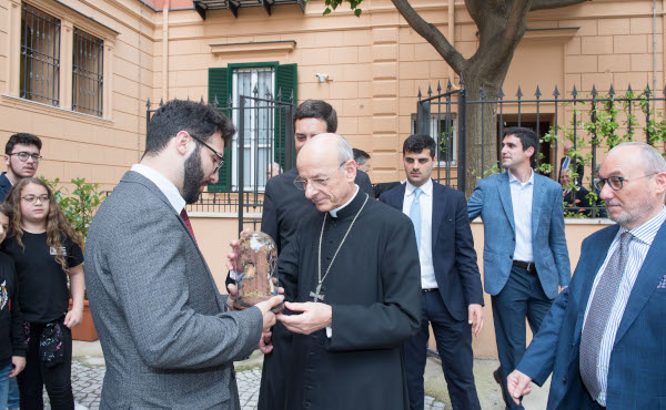 The Prelate receives the gift of a small Nativity scene made in Naples.