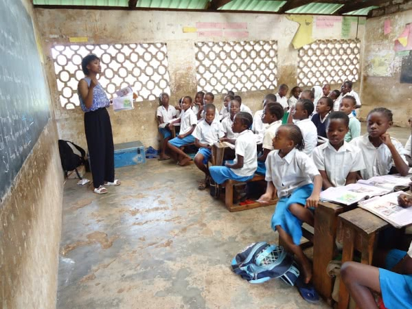 Christine has the class 3 pupils who normally have trouble learning English listening attentively