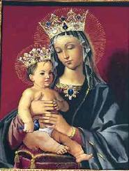 In het centrum van het retabel, omringd door engelen, wordt Onze Lieve Vrouw als Koningin van de Vrede weergegeven, geschilderd door M. Caballero.